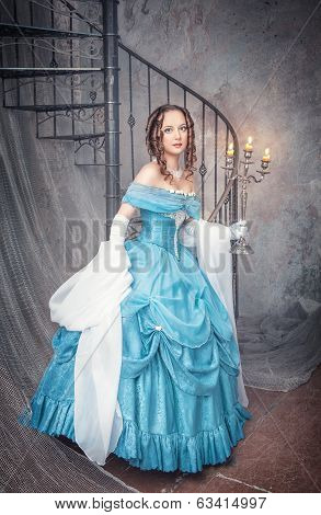 Beautiful Woman In Blue Medieval Dress With Candelabrum