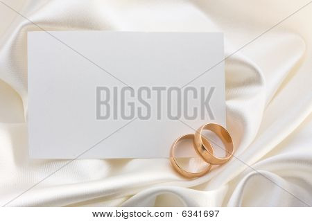 Two Wedding Rings And Card