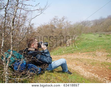 A man taking photo of a district