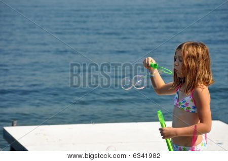 blowing bubbles at the lake