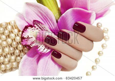 Maroon manicure.