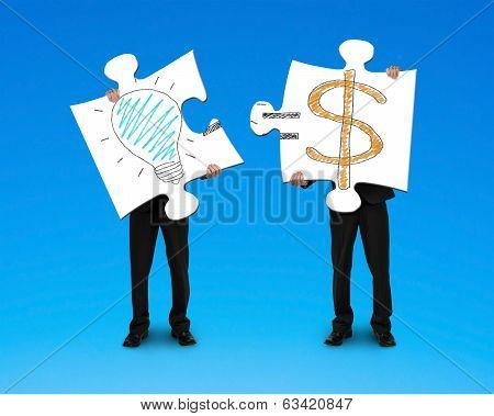 Holding 2 Puzzles With Bulb And Money Symbol Drawing