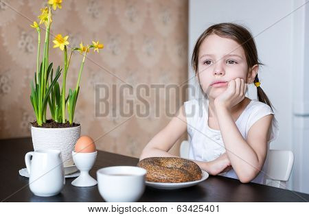Nice preschooler girl with breakfast