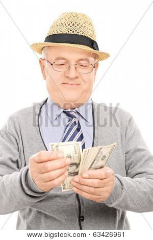 Senior gentleman counting money isolated on white background