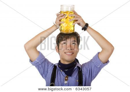 Asian Having Oktoberfest Beer Stein On His Hand And Smiles