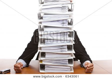 Business Man Sits In Front Of Huge Paperwork (folders)