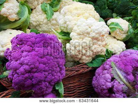 White and Purple Cauliflower in a straw basket at the Farmers market
