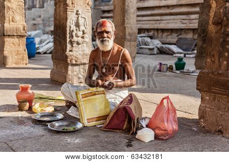 MADURAI, INDIA - FEBRUARY 16, 2013: Indian brahmin (traditional Hindu society) priest in famous Meenakshi Amman Temple - historic Hindu temple located in temple city Madurai