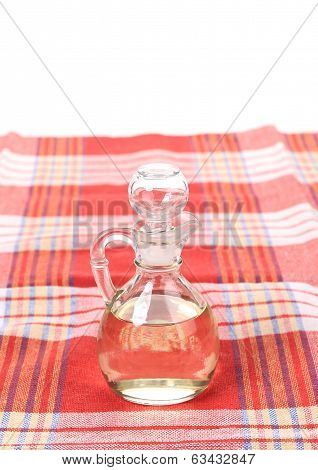 Vinegar in glass carafe on table.