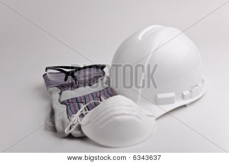 centered hard hat leather gloves safety glasses dust mask
