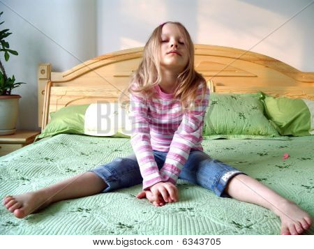 Girl sits on bed post