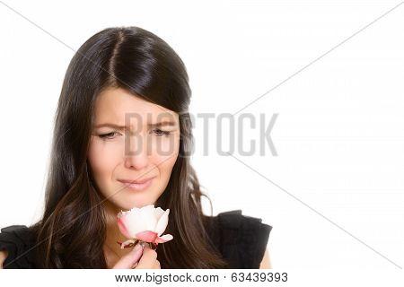 Sorrowful Woman Clutching A Single Rose