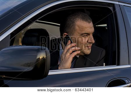 Driver On The Phone Looking Out Of Window