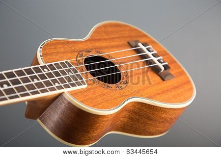 Close-up shot of classic ukulele guitar, selective focus on pattern