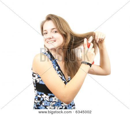 Girl Spraying Hair Lacquer Onto Her Hair