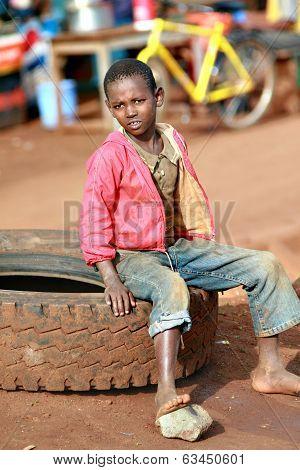 Barefoot  Boy, Resting, Sitting On Car Tire
