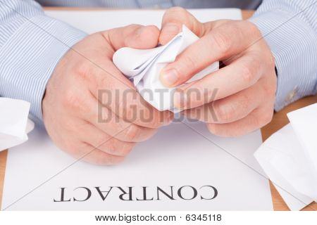 Businessman Crumpling Documents