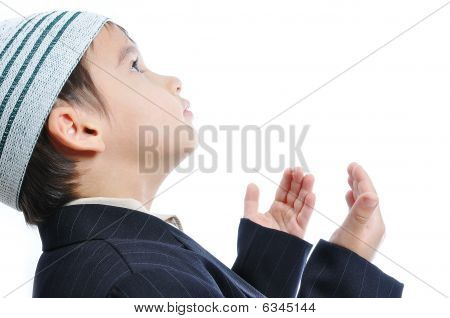 Muslim Little Cute Kid With Hat Praying, Isolated