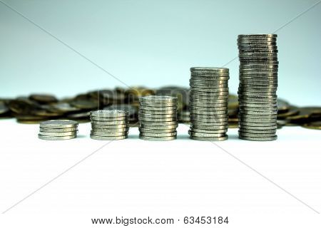Coins in piles