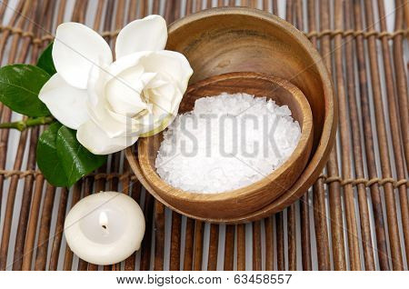 gardenia with candle white salt on bowl on bamboo mat