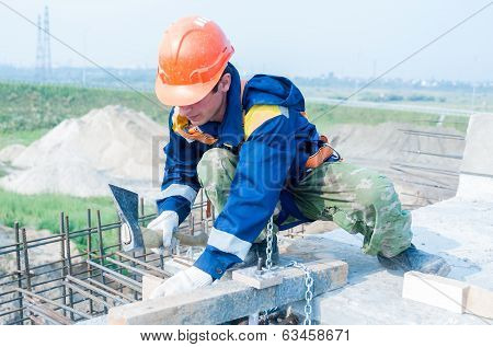 Worker on bridge construction