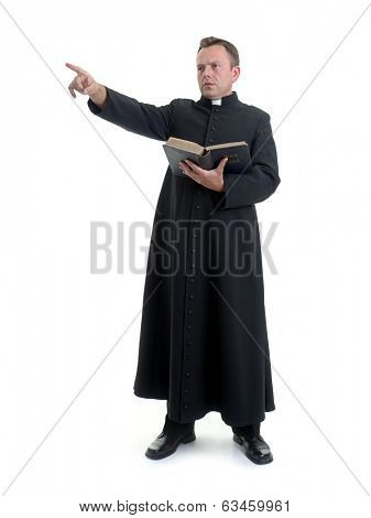 Catholic priest preaching while holding a Bible, against a white background.