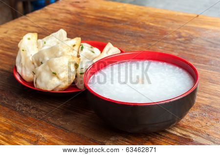 A Typical Chinese Breakfast Of Congee And Fried Pork Dumplings