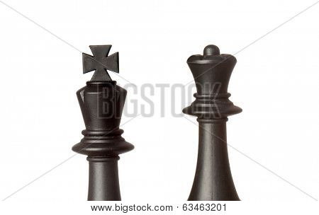 The king and queen. Wooden chess pieces isolated on a white background