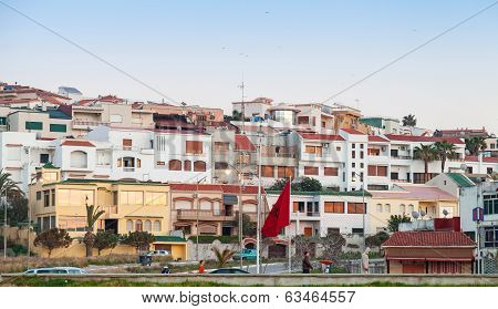 Street view with traditional colorful living houses and ordinary walking people