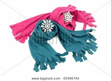 Pink and blue wool scarves nicely arranged.