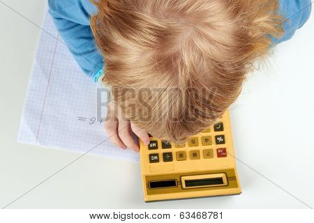 Child Does  Calculations With Retro Calculator