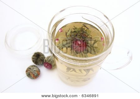 Herbal Tea With Tea Flower In Glass Cup
