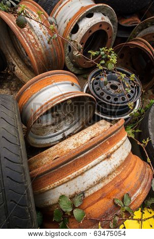rusting wheels in a scrapyard