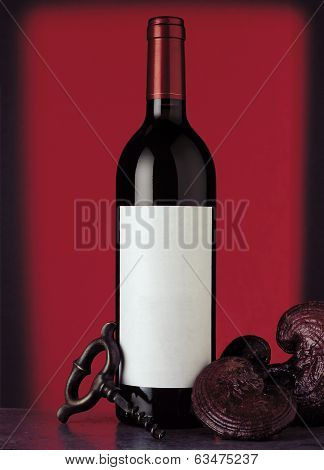 Bottle Of Red Wine With Red Background.
