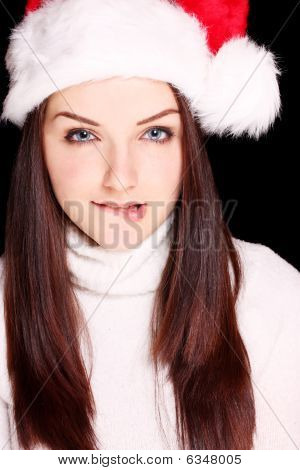 Girl Biting Her Lip Wearing Santa Hat
