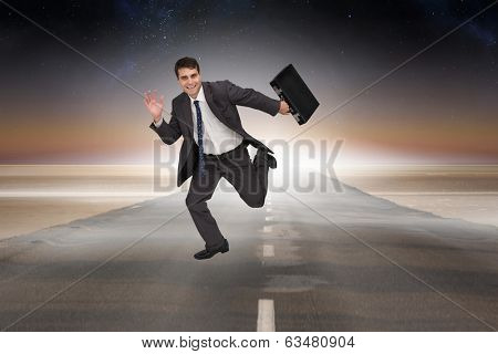 Cheerful businessman in a hurry against road leading out to the horizon