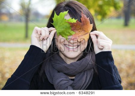Smiling Girl With Clorful Leaves