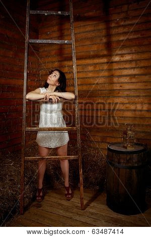 girl with a ladder looking up