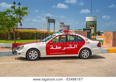 ABU DHABI, UAE - MARCH 27: Police car on the street of Abu Dhabi on March 27, 2014, UAE. Abu Dhabi is the capital and the second most populous city in the United Arab Emirates with 1 million people.