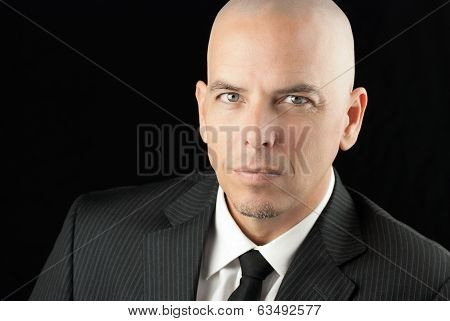 Focused Bald Man In Suit