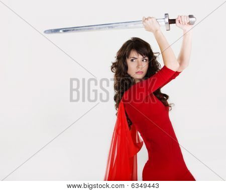 young beautiful girl with a sword in hands