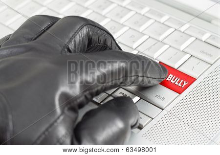 Online Bully Concept With Hand Wearing Black Glove