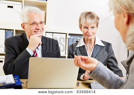 Elderly woman getting financial consultation in a bank