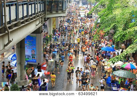 Bangkok, Thailand - April 13, 2014: Tourists in Silom road for Songkran festival in Thailand