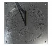 image of sundial  - An old vintage sundial clock made of scratched metal with roman numerals on an isolated white studio background - JPG