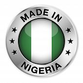 stock photo of nigeria  - Made in Nigeria silver badge and icon with central glossy Nigerian flag symbol and stars - JPG