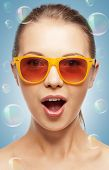summer holidays, beauty, happiness and people concept - teenage girl in shades with expression of su