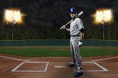 picture of ball cap  - Baseball Player on a Blue Uniform on baseball Stadium - JPG