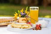 image of curd  - Outdoors breakfast - curd cheese pie and orange juice