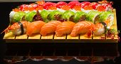 foto of sushi  - Fresh sushi roll with tasty ingredients on interesting background - JPG